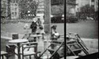 Relaxing in a crowded cafe during a thunderstorm
